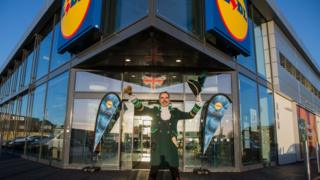 Town crier and Lidl store