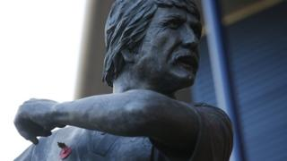 A statue of former player Tony Brown displays a poppy prior to the Sky Bet Championship match at The Hawthorns, West Bromwich