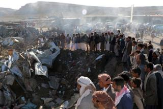 People gather at the site of a suspected Saudi-led coalition air strike in Sahar district, Saada province, Yemen (1 November 2017)