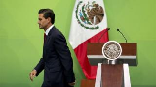 Mexican President Enrique Pena Nieto leaves the podium after speaking during an event to present a national policy on financial inclusion in Mexico, at the National Palace in Mexico City, Tuesday, June 21, 2016.