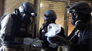 Chemical weapons experts collect samples from the site of an attack in Ain Tarma, Damascus, on 29 August 2013