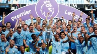 Manchester City celebrate winning the league