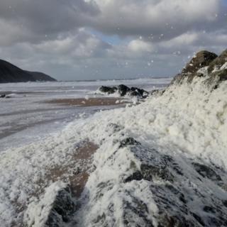 The foaming sea at Woolacombe Beach in Devon