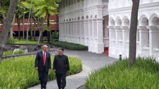 U.S. President Donald Trump walks with North Korean leader Kim Jong Un at the Capella Hotel on Sentosa island in Singapore June 12, 2018. Kevin Lim/The Straits Times via REUTERS ATTENTION EDITORS