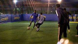 Men playing five-a-side football at a Powerleague site