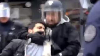 göstericiyi ve Macron'un koruması