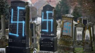 Graves desecrated with swastikas are seen in the Jewish cemetery in Quatzenheim, near Strasbourg, France, on 19 February 2019