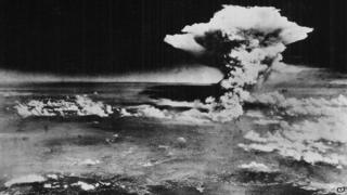 A plume of smoke from a mushroom cloud billows an hour after the nuclear bomb was detonated above Hiroshima, Japan on 6 August 1945