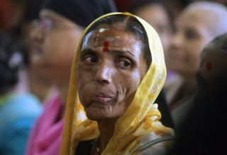 Indian cancer affected woman attends an International Women's Day celebration for patients of the Cancer Patients Aids Association in Mumbai, 08 March 2006.