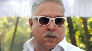 his file photo taken on December 21, 2013 shows Indian liquor baron Vijay Mallya at the launch of the Kingfisher 2014 calendar in Mumbai.