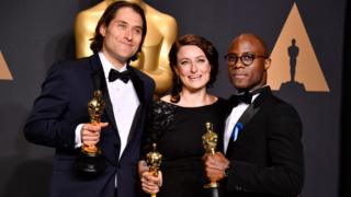 Moonlight producers Jeremy Kleiner and Adele Romanski with director Barry Jenkins