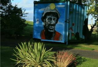 mural of miner in the grounds of the miners memorial garden Ballingry, Fife.