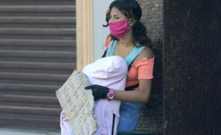 Woman with baby begging in Guayaquil, 16 Apr 20