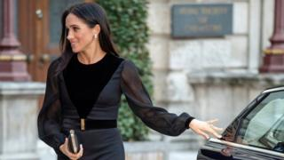 The Duchess of Sussex closes a car door