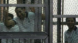 Samhi Moustafa inside a prison cage in Cairo