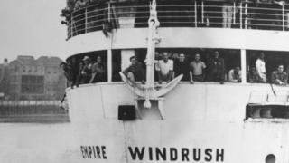 "The ex-troopship ""Empire Windrush"" arriving at Tilbury Docks from Jamaica, with 482 Jamaicans on board, emigrating to Britain"