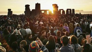 People gathered at Stonehenge