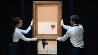 Banksy programmed a shredder to destroy his work A girl with balloon right after it was sold at Sotheby's auction house in London.