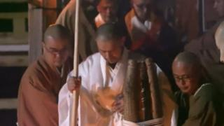 Kogan Kamahori surrounded by other monks as he emerges from the fast