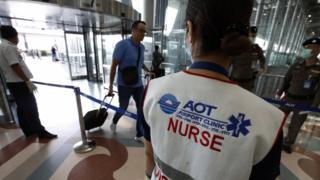 Thai officials monitor arrivals at Suvarnabhumi International Airport in Bangkok