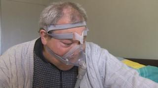 Photo of Alan McKitrick wearing breathing equipment