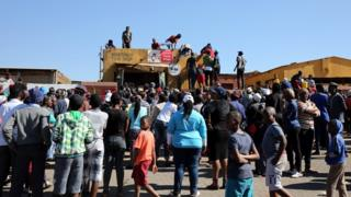 People looting a shop near Pretoria, South Africa