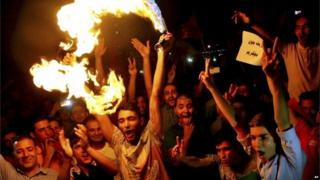 Iranians celebrate following a landmark nuclear deal in Tehran, Iran, Tuesday, July 14, 2015.