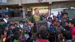 Jamie Jibberish entertaining children in Beirut