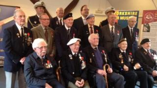 All twelve of the day's Légion d'Honneur recipients