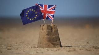 Sandcastle with EU and UK flags