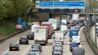 Slow-moving traffic on the M25 near Addlestone, Surrey
