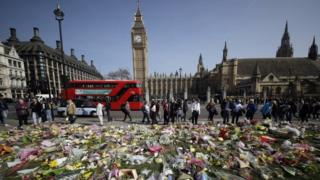 Floral tributes to the victims of the Westminster attack are placed outside the Palace of Westminster, London, Monday March 27, 2017