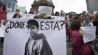 "Relatives and students hold posters reading ""Where is he?"" as they protest against the disappearance of student Marco Antonio Sanchez, at the Angel de la Independencia monument in Mexico City on January 28, 2018"