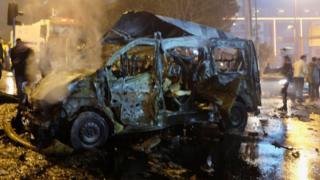 Damaged vehicle seen after blast in Istanbul, Turkey, 10 December 2016.