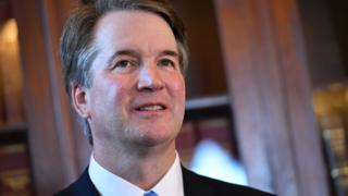 Brett Kavanaugh smiles during an appearance on Capitol Hill.