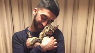 Hussein Sharaf and his cat Bruno