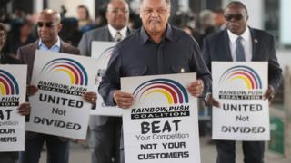 Civil rights leader Reverend Jesse Jackson leads a small group from the Rainbow PUSH Coalition in a protest outside the United Airlines terminal at O'Hare International Airport, 12 April 2017