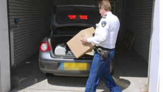 Police officers removing goods from the diamond exchange in Amsterdam during a national raid in May 2013