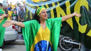 A woman cheers at a Jair Bolsonaro rally