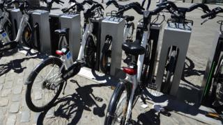 Electric bikes in a rack in Madrid