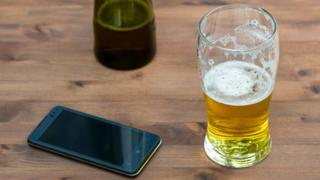 A pint glass and smartphone
