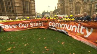 Steel workers unveil banner at Westminster