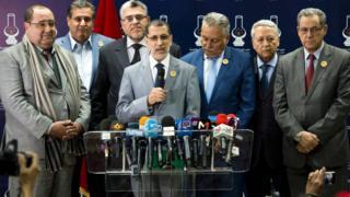 العثماني وبجواره قادة الأحزاب المشاركة في الائتلاف الحكومي الجديد