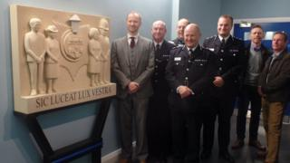 Mark gatiss and police with memorial