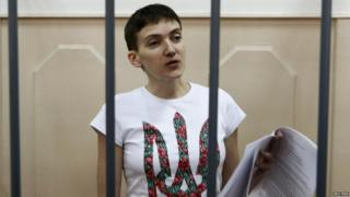 Ukrainian military pilot Nadia Savchenko stands inside a defendants' cage as she attends a court hearing in Moscow, Russia (6 May 2015)