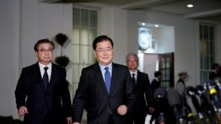 South Korean National Security Advisor Chung Eui-yong (C) and South Korea National Intelligence Service chief Suh Hoon (L) make their way to brief reporters outside the West Wing of the White House on March 8, 2018 in Washington, DC