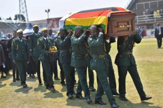 Soldiers carrying a coffin