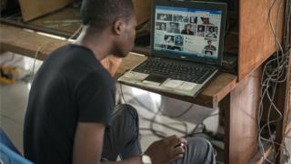 Clients surf the internet at an internet cafe on February 25, 2015 in Kinshasa, DR Congo.