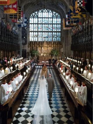 "Meghan Markle walks up the aisle with the Prince of Wales at St George""s Chapel at Windsor Castle"