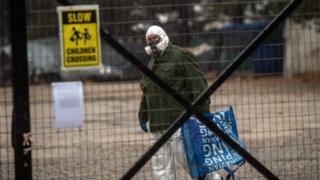Man wearing a protective suit at Malakasa camp. Greece (05/04/20)